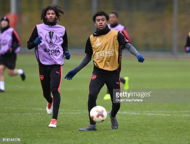 Mohamed Elneny and Alex Iwobi of Arsenal during a training session at London Colney on February 14 2018 in St Albans United Kingdom