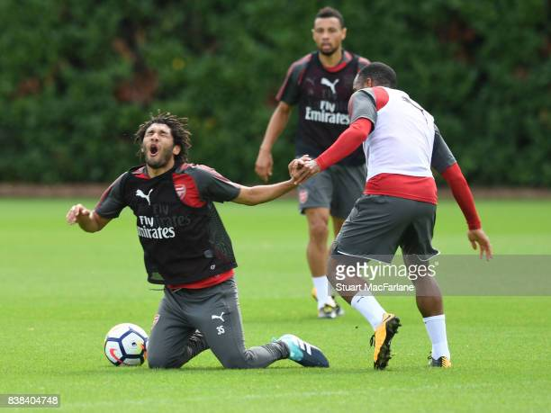Mohamed Elneny and Alex Lacazette of Arsenal during a training session at London Colney on August 24, 2017 in St Albans, England.