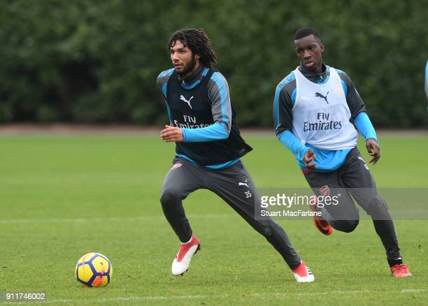 Mohamed Elneny and Eddie Nketiah of Arsenal during a training session at London Colney on January 29 2018 in St Albans England