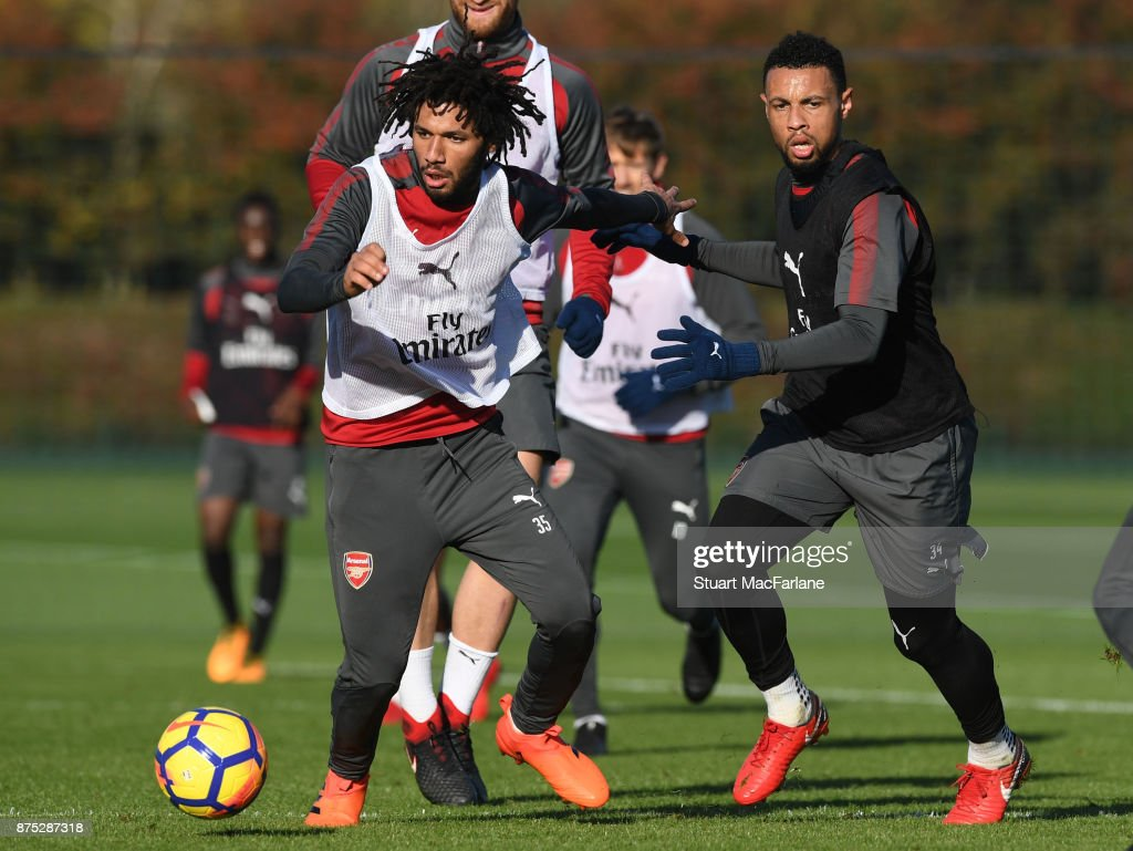 Mohamed Elneny and Francis Coquelinof Arsenal during a training session at London Colney on November 17, 2017 in St Albans, England.