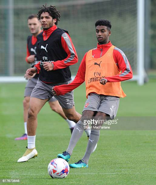 Mohamed Elneny and Gedion Zelalem of Arsenal during a training session at London Colney on October 24 2016 in St Albans England