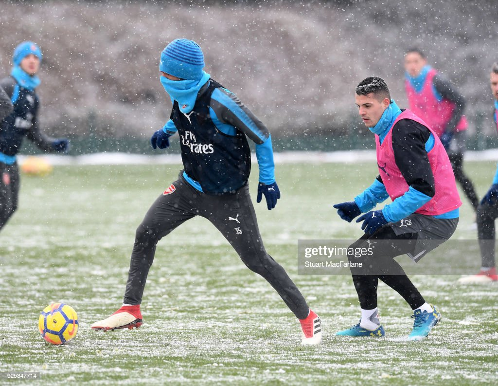 Mohamed Elneny and Granit Xhaka of Arsenal during a training session at London Colney on February 28, 2018 in St Albans, England.