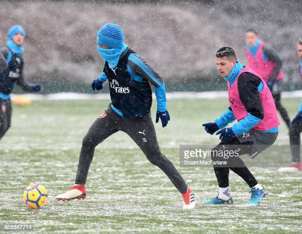 Mohamed Elneny and Granit Xhaka of Arsenal during a training session at London Colney on February 28 2018 in St Albans England