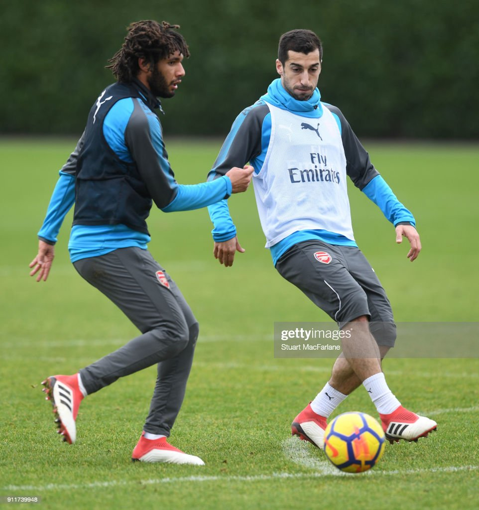 Mohamed Elneny and Henrikh Mkhitaryan of Arsenal during a training session at London Colney on January 29, 2018 in St Albans, England.