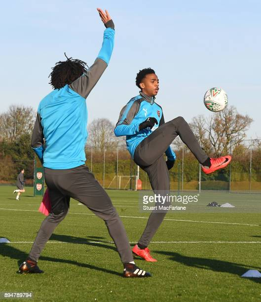 Mohamed Elneny and Joe Willock of Arsenal during a training session at London Colney on December 18 2017 in St Albans England