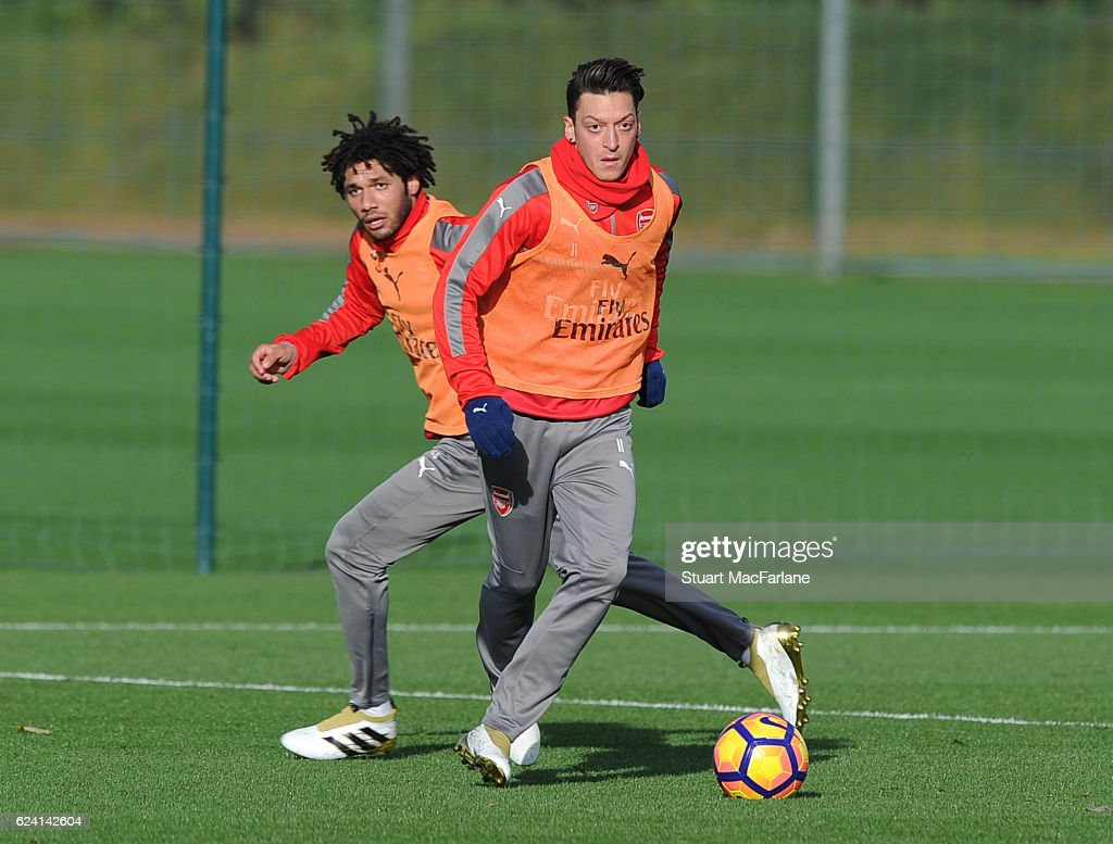 Mohamed Elneny and Mesut Ozil of Arsenal during a training session at London Colney on November 18, 2016 in St Albans, England.