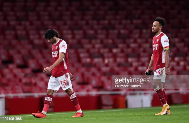 Mohamed Elneny and Pierre-Emerick Aubameyang of Arsenal look dejected as they leave the pitch following the Premier League match between Arsenal and...