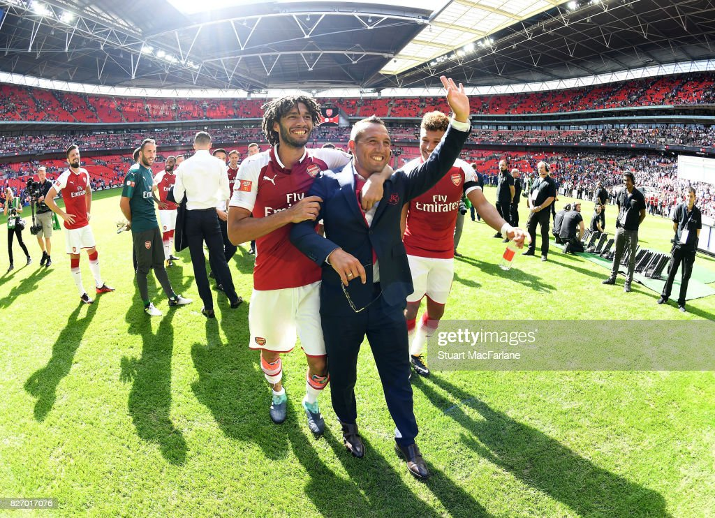Mohamed Elneny and Santi Cazorla after the FA Community Shield match between Chelsea and Arsenal at Wembley Stadium on August 6, 2017 in London, England.