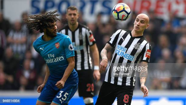 Mohamed Elneny challenges Jonjo Shelvey of Newcastle during the Premier League match between Newcastle United and Arsenal at St James Park on April...