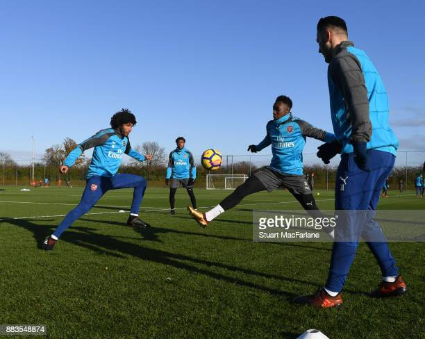 Mohamed Elneny Danny Welbeck and Sead Kolasinac of Arsenal during a training session at London Colney on December 1 2017 in St Albans England