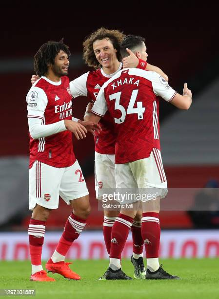 Mohamed Elneny, David Luiz and Granit Xhaka of Arsenal celebrate following their side's victory in the Premier League match between Arsenal and...
