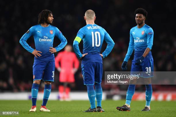 Mohamed Elneny Jack Wilshere and Ainsley MaitlandNiles of Arsenal looks dejected during UEFA Europa League Round of 32 match between Arsenal and...