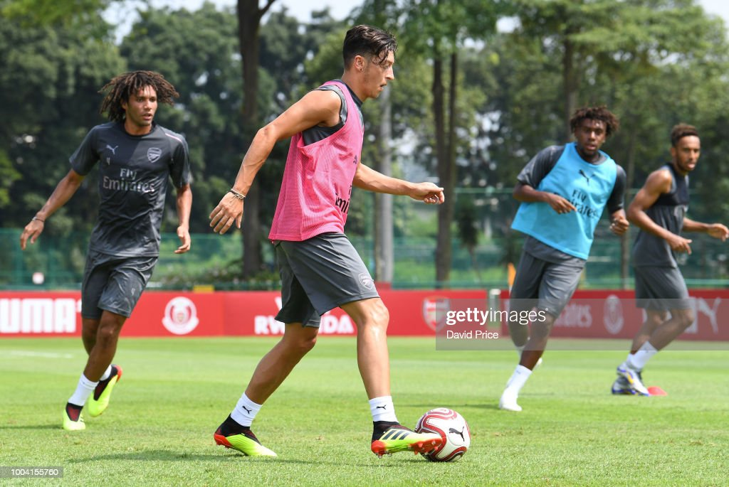 Mohamed Elneny, Mesut Ozil and Alex Iwobi of Arsenal during an Arsenal Training Session at Singapore American School on July 23, 2018 in Singapore.