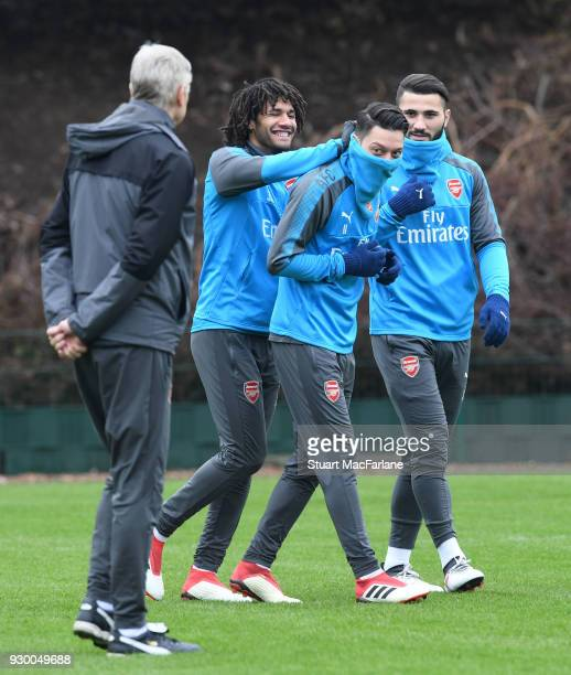 Mohamed Elneny Mesut Ozil and Sead Kolasinac of Arsenal during training at London Colney on March 10 2018 in St Albans England
