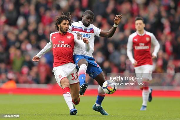 Mohamed Elneny of Arsenal and Badou Ndiaye of Stoke City during the Premier League match between Arsenal and Stoke City at Emirates Stadium on April...