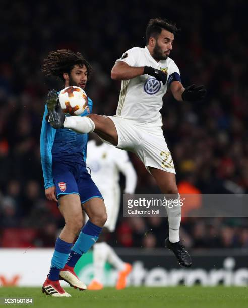 Mohamed Elneny of Arsenal and Brwa Nouri of Ostersunds FK during UEFA Europa League Round of 32 match between Arsenal and Ostersunds FK at the...