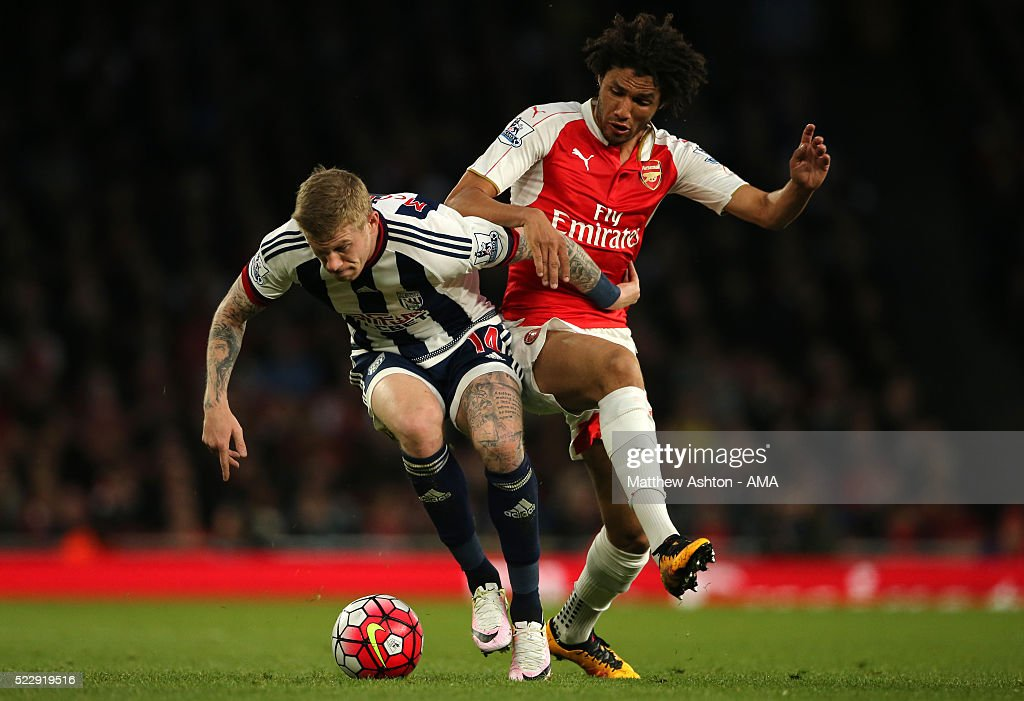 Mohamed Elneny of Arsenal and James McClean of West Bromwich Albion compete during the Barclays Premier League match between Arsenal and West Bromwich Albion at the Emirates Stadium, on April 21, 2016 in London, England.