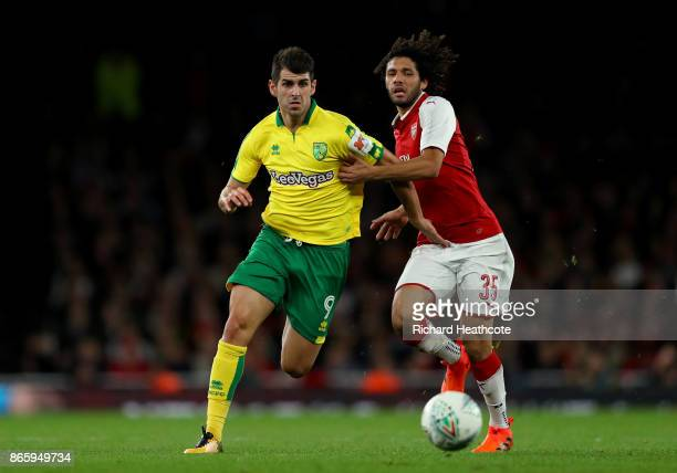 Mohamed Elneny of Arsenal and Nelson Oliveira of Norwich City during the Carabao Cup Fourth Round match between Arsenal and Norwich City at Emirates...