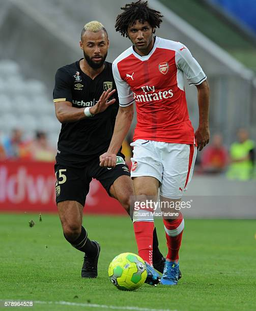 Mohamed Elneny of Arsenal breaks past John Bostock of Lens during a pre season friendly between RC Lens and Arsenal at Stade BollaertDelelis on July...