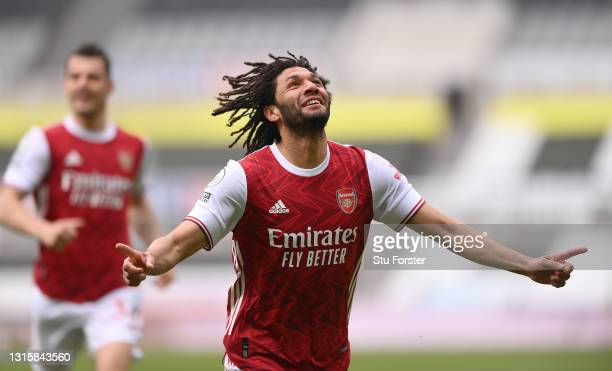 Mohamed Elneny of Arsenal celebrates after scoring their side's first goal during the Premier League match between Newcastle United and Arsenal at...