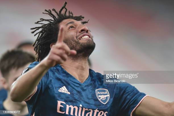 Mohamed Elneny of Arsenal celebrates after scoring their side's third goal during the UEFA Europa League Round of 16 First Leg match between...