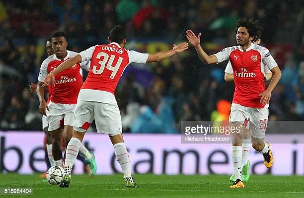 Mohamed Elneny of Arsenal celebrates scoring his team's first goal with his team mate Francis Coquelin during the UEFA Champions League round of 16...