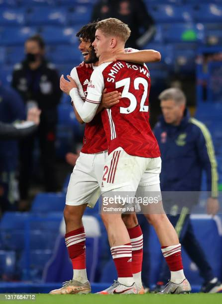 Mohamed Elneny of Arsenal celebrates victory with team mate Emile Smith Rowe after the Premier League match between Chelsea and Arsenal at Stamford...