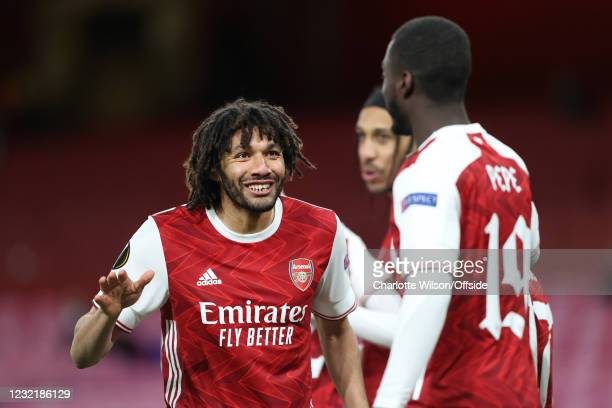 Mohamed Elneny of Arsenal celebrates with goalscorer Nicolas Pepe of Arsenal during the UEFA Europa League Quarter Final First Leg match between...