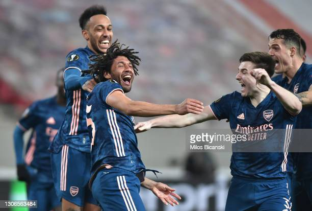 Mohamed Elneny of Arsenal celebrates with team mates Kieran Tierney and Pierre-Emerick Aubameyang after scoring their side's third goal during the...