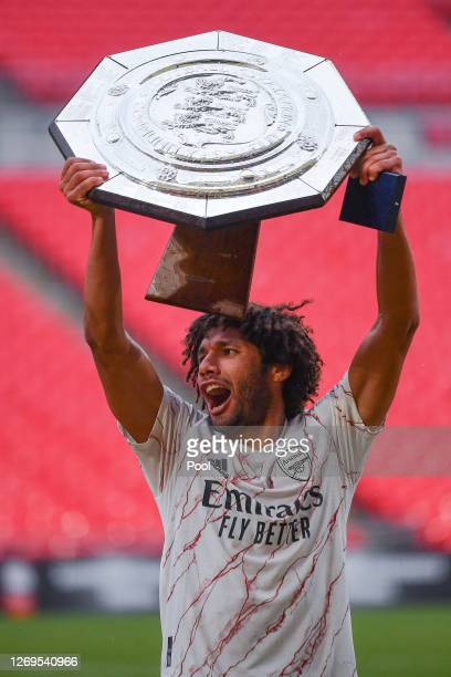 Mohamed Elneny of Arsenal celebrates with the Community Shield Trophy following his team's victory in the FA Community Shield final between Arsenal...