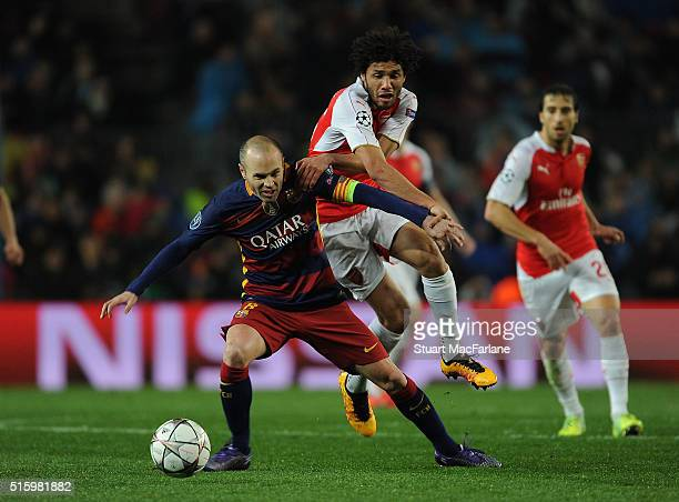 Mohamed Elneny of Arsenal challenges Andres Inesta of Barcelona during the UEFA Champions League Round of 16 2nd Leg match between Barcelona and...