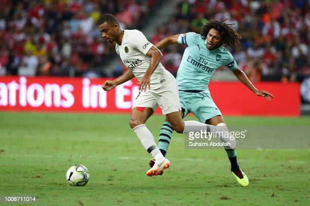 Mohamed Elneny of Arsenal challenges Antoine Bernede of Paris Saint Germain for the ball during the International Champions Cup match between Arsenal...