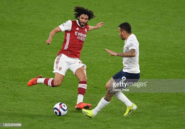 Mohamed Elneny of Arsenal challenges Gabriel Jesus of Man City during the Premier League match between Arsenal and Manchester City at Emirates...