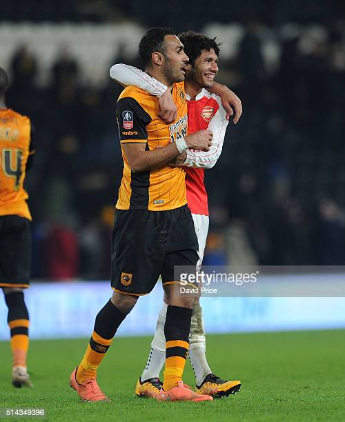 Mohamed Elneny of Arsenal chats to Ahmed Elmohamady of Hull after the match between Hull City and Arsenal in the FA Cup 5th round at KC Stadium on...