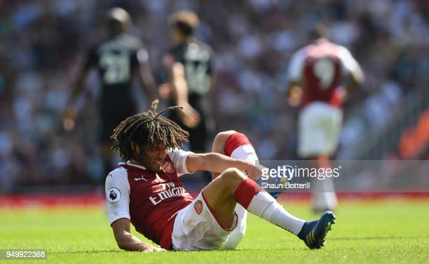 Mohamed Elneny of Arsenal goes down injured during the Premier League match between Arsenal and West Ham United at Emirates Stadium on April 22 2018...