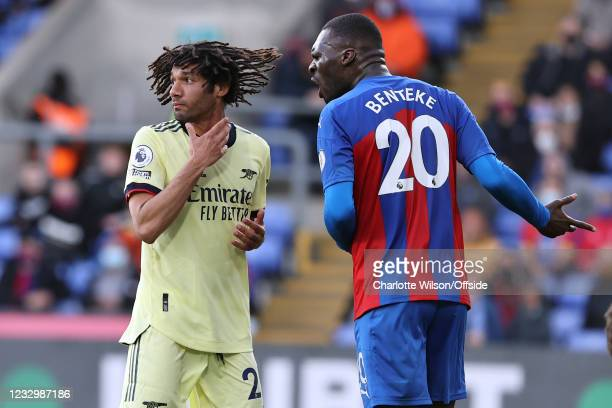 Mohamed Elneny of Arsenal implies that Christian Benteke of Crystal Palace grabbed him by the neck by holding his hand to his throat during the...