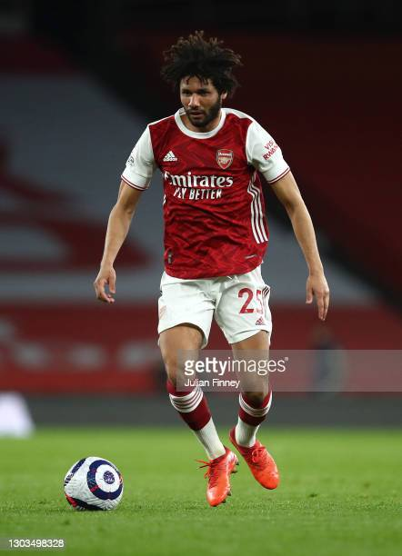 Mohamed Elneny of Arsenal in action during the Premier League match between Arsenal and Manchester City at Emirates Stadium on February 21, 2021 in...