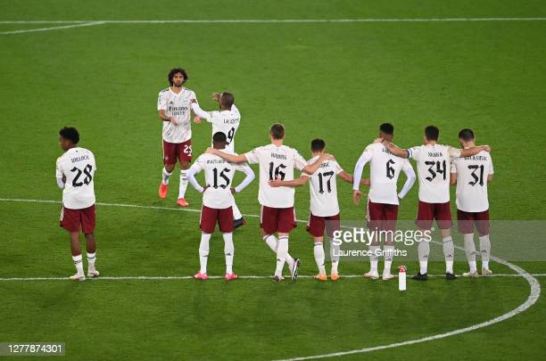 Mohamed Elneny of Arsenal is embraced by Alexandre Lacazette of Arsenal after missing his sides second penalty during the penalty shoot out during...