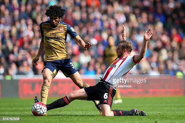 Mohamed Elneny of Arsenal is tackled by Lee Cattermole of Sunderland during the Barclays Premier League match between Sunderland and Arsenal at the...