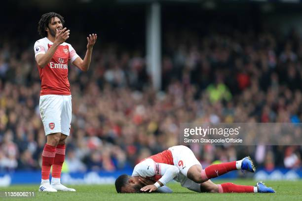 Mohamed Elneny of Arsenal looks dejected as Alexandre Lacazette of Arsenal lies injured during the Premier League match between Everton and Arsenal...