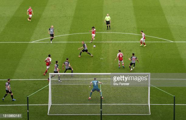 Mohamed Elneny of Arsenal scores their side's first goal past Martin Dubravka of Newcastle United during the Premier League match between Newcastle...