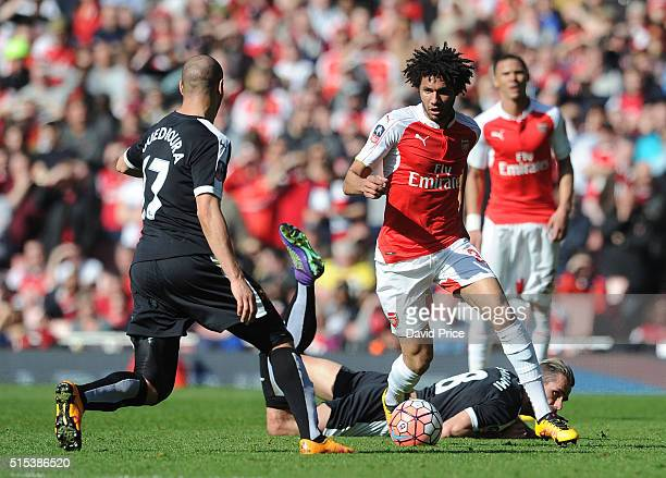 Mohamed Elneny of Arsenal takes on Adlene Guedioura of Watford during the match between Arsenal and Watford in the FA Cup 6th round at Emirates...