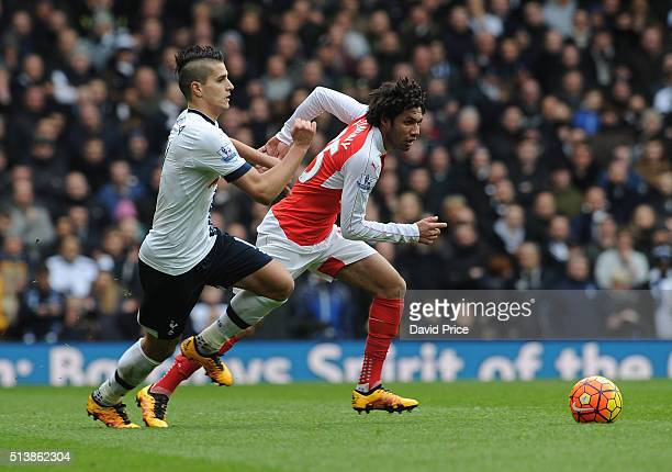 Mohamed Elneny of Arsenal takes on Erik Lamela of Tottenham during the Barclays Premier League match between Tottenham Hotspur and Arsenal at White...