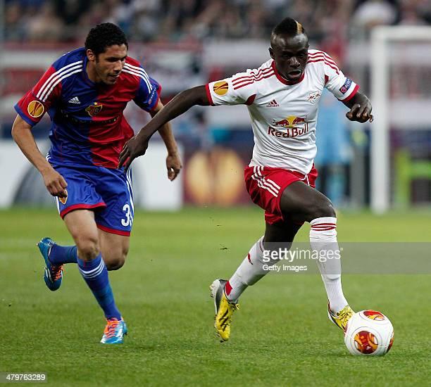 Mohamed Elneny of Basel challenges Sadio Mane of Salzburg during the UEFA Europa League Round of 16 match between FC Salzburg and FC Basel 1893 at...