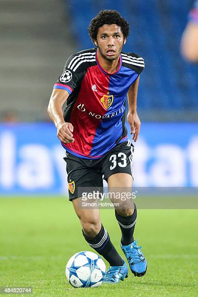 Mohamed Elneny of Basel controls the ball during the UEFA Champions League qualifying round play off first leg match between FC Basel and Maccabi Tel...