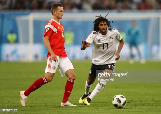 Mohamed Elneny of Egypt challenge for the ball with Denis Cheryshev of Russia during the 2018 FIFA World Cup Russia group A match between Russia and...