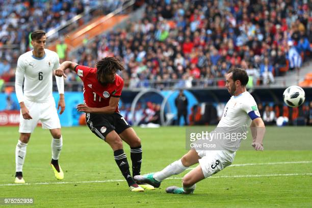 Mohamed Elneny of Egypt is challenged by Diego Godin of Uruguay during the 2018 FIFA World Cup Russia group A match between Egypt and Uruguay at...