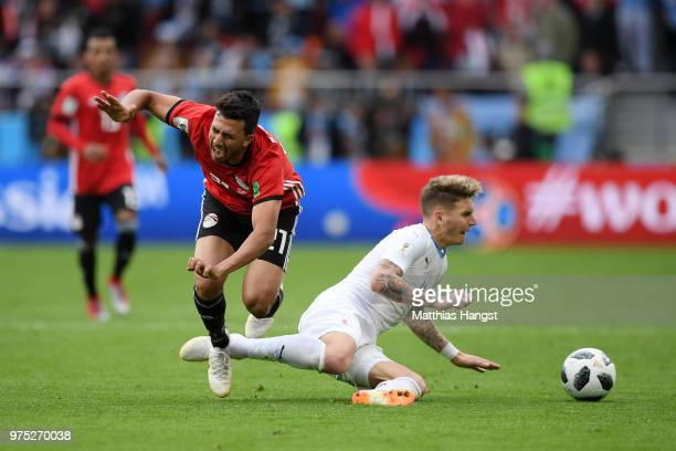 Mohamed Elneny of Egypt is challenged by Guillermo Varela of Uruguay during the 2018 FIFA World Cup Russia group A match between Egypt and Uruguay at...