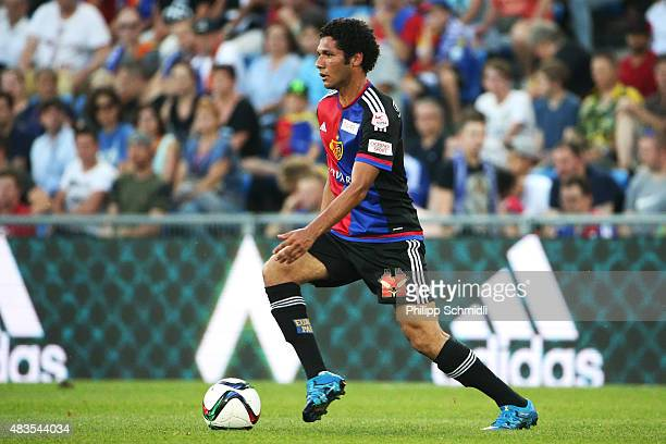 Mohamed Elneny of FC Basel runs with the ball during the UEFA Champions League third qualifying round 2nd leg match between FC Basel 1893 and KKS...