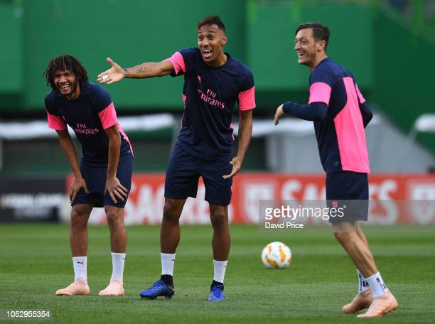 Mohamed Elneny PierreEmerick Aubamyang and Mesut Ozil of Arsenal during the Arsenal Training Session at Estadio Jose Alvalade on October 24 2018 in...